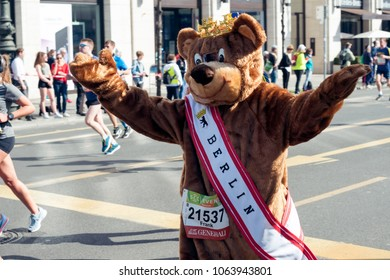 Berlin, Germany - April 08, 2018: Man dressed as bear with Berlin stripe running on the Unter den Linden Street during the 38th edition of the biggest German half marathon