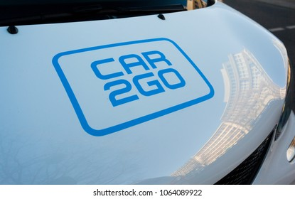 Berlin, Germany - April 08 2018: Close-up of a the Car2Go Logo on the Hood of a white Smart Car