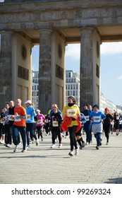 BERLIN, GERMANY - APRIL 1: A group of runner pass under the Brandenburg Gate during the 32nd Vatenfall Berlin half marathonon on April 1, 2012 in Berlin, Germany.