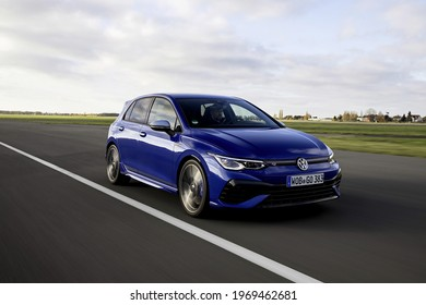 Berlin, Germany - April 10, 2021: A blue Volkswagen Golf R is driven on road