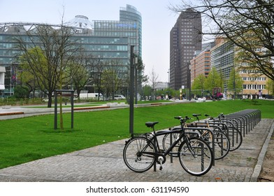 Berlin, Germany - April 12, 2017: Many parked bicycles in the background of the skyscrapers of the business center in Berlin.