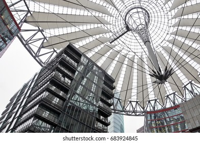 Berlin, Germany - April 12, 2017: Look up at the modern office building and translucent dome on Potsdamer Platz in Berlin.