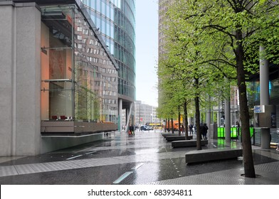 Berlin, Germany - April 12, 2017: Modern street with skyscrapers on Potsdam Square in Berlin after the rain.