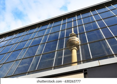 Berlin, Germany - April 13, 2017: Reflection of the Berlin Television tower Fernsehturm on a glass facade.
