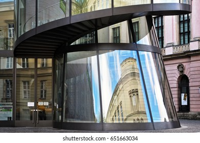 Berlin, Germany - April 13, 2017: German Historical Museum in Berlin. Curve glass reflected old building.