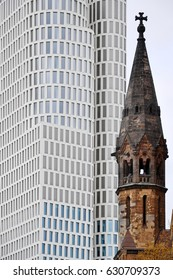 Berlin, Germany - April 14, 2017: Tower of Kaiser Wilhelm Memorial Church in Kurfurstendamm on a background of white modern skyscraper.