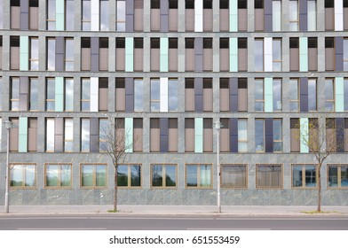 Berlin, Germany - April 14, 2017: Front facade of modern building of different colored vertical panels.
