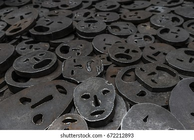 Berlin, Germany - April 14, 2017: Memory Void is a exposure of piles of metal faces symbolizing the horror of the Holocaust in the Jewish Museum in Berlin, Germany