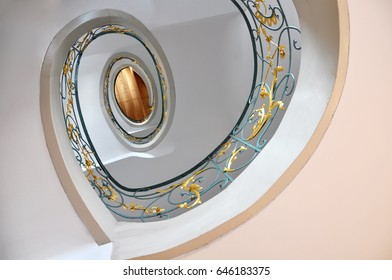 Berlin, Germany - April 15, 2017: Look up at the round staircase with a decorative fence in the style of Ar Nouveau. Architectural composition.