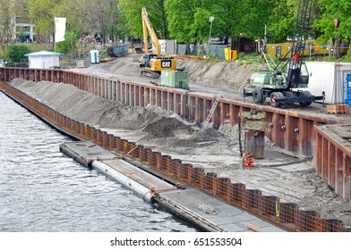 Berlin, Germany - April 15, 2017: The process of construction of the embankment. Installation of metal formwork and mound. Excavators in the background.