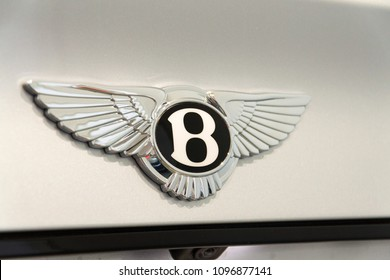 BERLIN, GERMANY - APRIL 15 2018: Bentley company logo on Bentley Bentayga car standing at Volkswagen Group forum Drive on April 15, 2018 in Berlin, Germany.