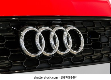 BERLIN, GERMANY - APRIL 15 2018: Audi company logo on Audi RS 5 car standing at Volkswagen Group forum Drive on April 15, 2018 in Berlin, Germany.