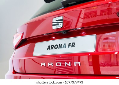 BERLIN, GERMANY - APRIL 15 2018: Seat company logo on Seat Arona FR car standing at Volkswagen Group forum Drive on April 15, 2018 in Berlin, Germany.