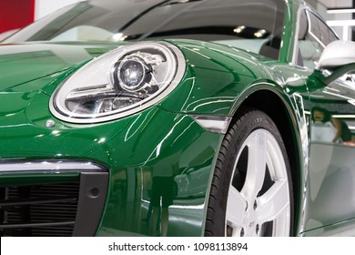 BERLIN, GERMANY - APRIL 15 2018: Porsche 911 Carrera S green car standing at Volkswagen Group forum Drive on April 15, 2018 in Berlin, Germany.