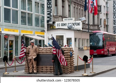 "BERLIN, GERMANY - APRIL 15: Former bordercross checkpoint ""Point Charlie"" in Berlin on April 14, 2012. It's the best-known Berlin Wall crossing point between East and West Berlin during the Cold War."