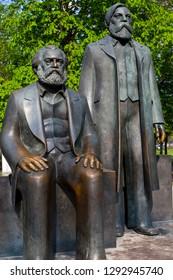 Berlin, Germany - April 17th 2011: Statue of Karl Marx & Friedrich Engels located in Marx-Engels-Forum in Berlin, Germany.  Marx and Engels were the authors of the Communist Manifesto of 1848.