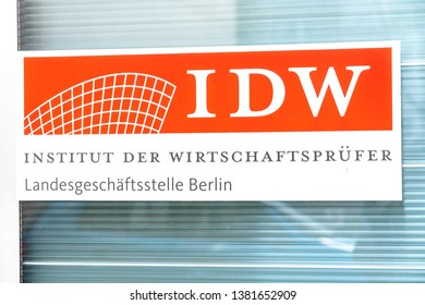 Berlin, Germany - April 18, 2019: Sign of the Institut der Wirtschaftsprüfer (IDW), German Institute of Auditors, association promoting and supporting the work of the auditors and accounting firms
