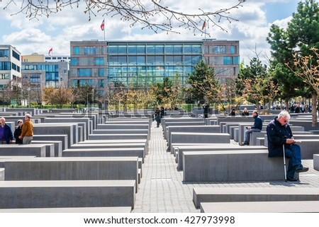 BERLIN, GERMANY - APRIL 20, 2016: Memorial to the Murdered Jews of Europe (Holocaust Memorial) - 2711 concrete blocks whit different highs and parallel alignment placed on 19.000 sqm urban area.