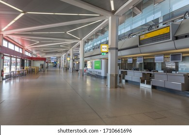 """BERLIN, GERMANY - April 2020,  empty main Airport Terminal - A, at Berlin Tegel """"Otto Lilienthal"""" Airport, during the corona pandemic lockdown caused by the novel coronavirus - all shops closed"""