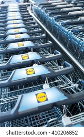 Berlin, Germany - April 21, 2016: line of carts in Lidl supermarket. Vertical shot. Lidl is a successful chain of grocery stores