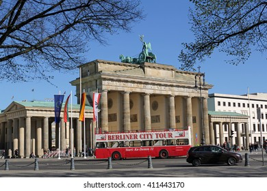 BERLIN, GERMANY, APRIL 21, 2016: tourist bus in front of Brandenburg Gate (Brandenburger Tor) in Berlin. It's the most recognizable landmark of Berlin.