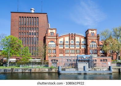 Berlin, Germany - April 22, 2018: Brick Gothic historic machine hall of the cogeneration plant Charlottenburg as seen from the river Spree
