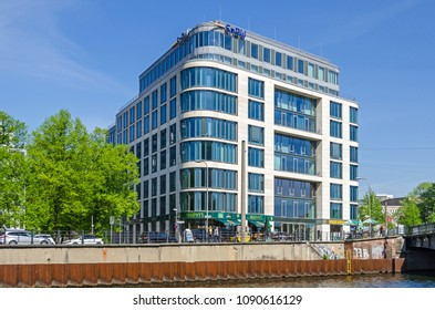 Berlin, Germany - April 22, 2018: River Spree and its bank Schiffbauerdamm, modern representative building of the EnBW, a publicly traded electric utilities company with the Murphys Irish pub