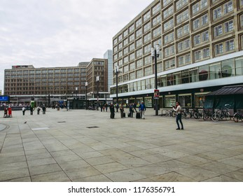 BERLIN, GERMANY - APRIL 24, 2010: Turists visiting Alexander Platz, the central square in East Berlin, which was designed by German architect Peter Behrens