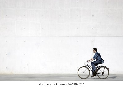 Berlin, Germany, April 25, 2006: Unidentified bicycle riders near Berlin parliament building. Bicycles are the best way to see the most Berlin interesting sites. Concrete wall background