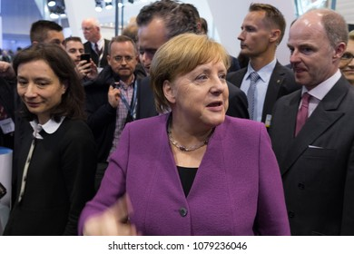 BERLIN, GERMANY - APRIL 25, 2018: Visit of Chancellor of Germany Angela Merkel to the stand of Liebherr Group. Exhibition ILA Berlin Air Show 2018.