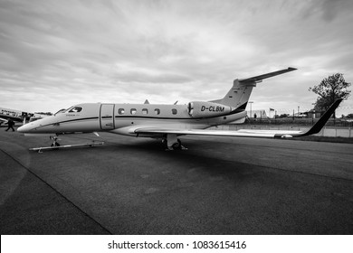 BERLIN, GERMANY - APRIL 25, 2018: Light business jet Embraer EMB-505 Phenom 300. Black and white. Exhibition ILA Berlin Air Show 2018