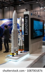 BERLIN, GERMANY - APRIL 25, 2018: The stand of the first commercial launch service provider Arianespace and models of rockets Soyuz and Ariane 5. Exhibition ILA Berlin Air Show 2018.