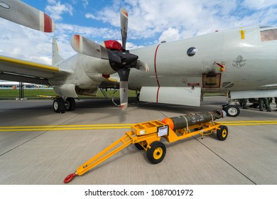 BERLIN, GERMANY - APRIL 25, 2018: Maritime patrol aircraft Lockheed P-3C Orion and lightweight antisubmarine torpedo Mark 46, Mod 5 in the foreground. German Navy. Exhibition ILA Berlin Air Show 2018.
