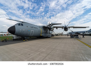 BERLIN, GERMANY - APRIL 25, 2018: Strategic/tactical airlift Airbus A400M Atlas on the airfield. German Air Force. Exhibition ILA Berlin Air Show 2018.
