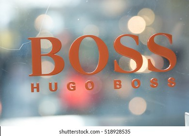 Berlin, Germany - April 26, 2016: Hugo Boss logo outside a store. It is a famous German fashion label founded by Hugo Boss in 1924
