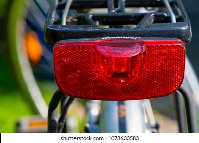 Berlin, Germany - April 27, 2018: Taillight of a bicycle with part of the luggage rack