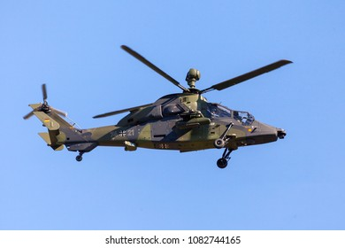 BERLIN / GERMANY - APRIL 28, 2018: Military twin-engined attack helicopter Tiger, from Airbus Helicopters flies at airport Berlin / Schoenefeld.