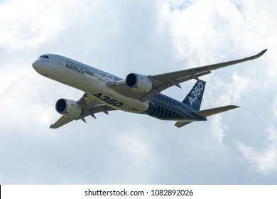 BERLIN / GERMANY - APRIL 28, 2018:  Airbus A350 XWB plane flies at airport Berlin / Schoenefeld. The Airbus A350 XWB is a family of long-range, twin-engine wide-body jet airliners.