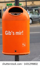 "BERLIN, GERMANY – APRIL 28, 2019: Recycle bin in downtown Berlin with the inscription ""give it to me"""