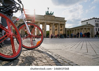 BERLIN, GERMANY – APRIL 28, 2019: Bicycles of the Chinese company Mobike in front of the Brandenburg Gate in Berlin