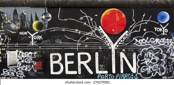 Berlin, Germany - April 28th, 2015: Paintings on the Berlin Wall in the East Side Gallery.
