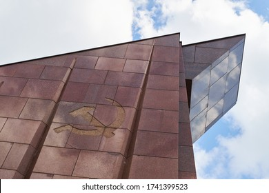 BERLIN, GERMANY - APRIL 29, 2016: Detail of the red granite entrance building with the soviet hammer and sickle symbol at the Soviet Memorial Park in Treptower Park.