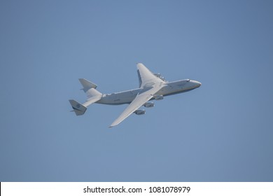 Berlin Schönefeld, Germany, April 29, 2018. Antonov An-225 Mriya - the largest cargo plane in the world performs in a clear blue sky at the ILA 2018 International Air Show in Berlin