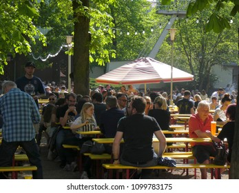 Berlin, Germany - April 29, 2018: Crowd of people chilling out outdoors on a terrace restaurant
