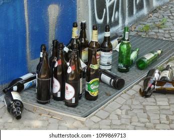 Berlin, Germany - April 29, 2018: Empty glass bottles abandoned on an urban street