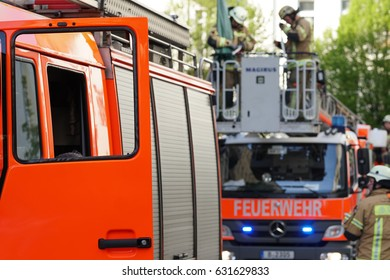 Berlin, Germany - April 30, 2017: fire department service truck and firemen. 112 is the single European emergency number that can be dialed free of charge is used for fire and medical emergency