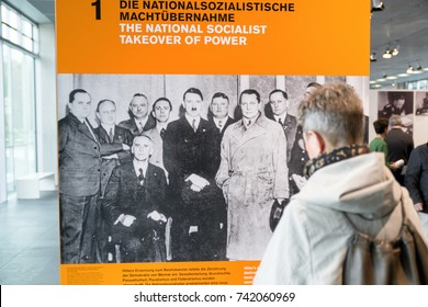 BERLIN, GERMANY - APRIL 7: Man looking on photography of Adolf Hitler at museum Topography of Terror,on April 7, 2017 in Berlin