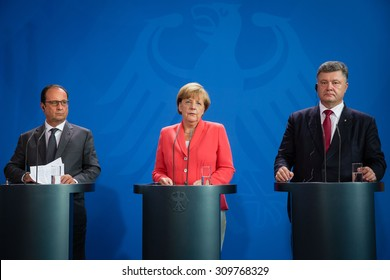 BERLIN, GERMANY - Aug 24, 2015: French President Francois Hollande, Chancellor of Federal Republic of Germany Angela Merkel and President of Ukraine Petro Poroshenko during a joint briefing in Berlin
