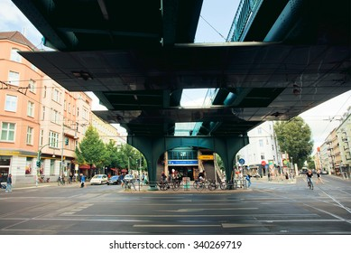 BERLIN, GERMANY - AUG 30: People walk around undeground station Eberswalder Strasse U-Bahn, designed in 1913 on August 30, 2015. Urban area of Berlin comprised 4 mill. people, 7th most populous in EU
