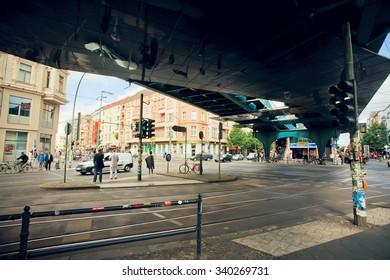 BERLIN, GERMANY - AUG 30: People crossing road under bridge near undeground station Eberswalder Strasse U-Bahn on August 30 2015. Urban area of Berlin comprised 4 mill. people, 7th most populous in EU